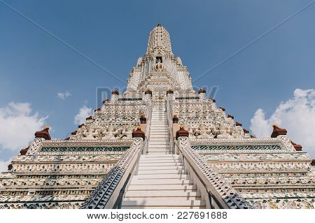 Low Angle View Of Ancient Temple With Decorative Statues In Bangkok, Thailand