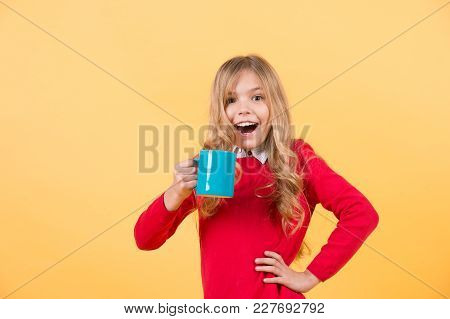Tea Or Coffee Break. Girl With Long Blond Hair In Red Sweater With Mug. Health And Healthy Drink. Ch