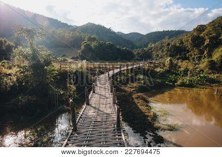 Wooden Footbridge Through Green Vegetation At Pai, Thailand