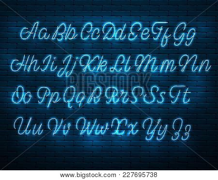 Latin Neon Font. Glowing Alphabet, Electric Stand, Against A Brick Wall Background, Calligraphic Abc