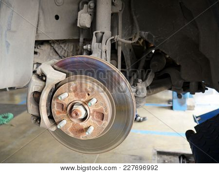 Front Disk Brake System Of The Car After Remove The Tire For Repair And Maintenance At Car Service C