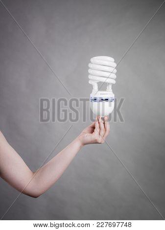 Woman Hand Holding Eco Modern Light Bulb. Innovation Technology, Power Saving Concept.
