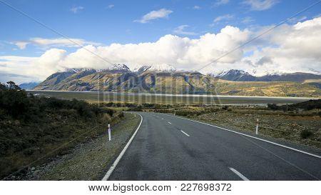 Road Leading To Aoraki Mount Cook Village In Aoraki Mount Cook National Park, South Island, New Zeal