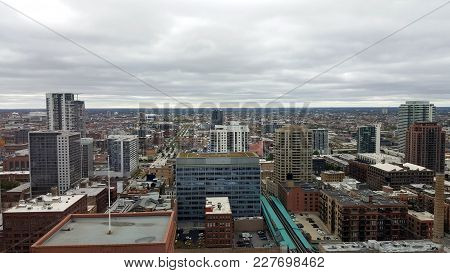 Aerial Elevated View Above The West Loop Neighborhood Of Chicago Looking West With Elevated Tracks