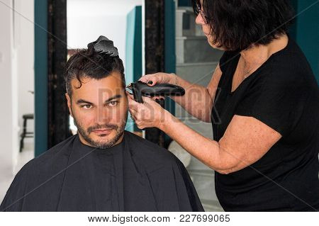 Female Barber Working With Hair Clipper, Shaving Young Man's Head