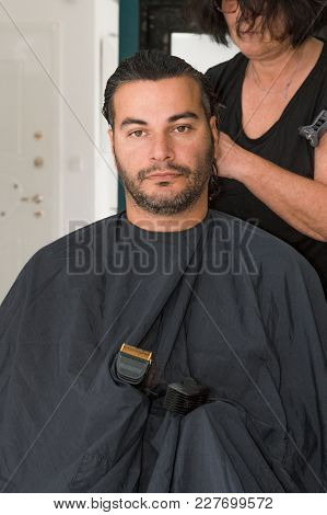 Female Barber Working With Hair Clipper, Combing Young Man's Head