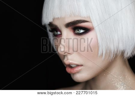 Side View Portrait. Sexy Blonde Woman Model With Makeup, Cheekbones And Healthy Shiny Skin. Evening