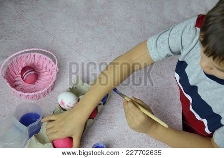 Easter, Family, Holiday And Child Concept - Close Up Of Little Boy Coloring Eggs For Easter