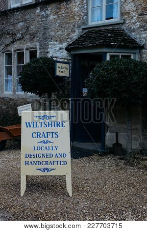Lacock, England - February 4, 2018: Storefront And Sign Outside Wiltshire Crafts, A Small Cooperativ
