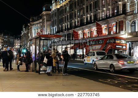 London, Uk - January 24, 2017: People And Traffic On Regent Street, A Major Shopping Street In The W