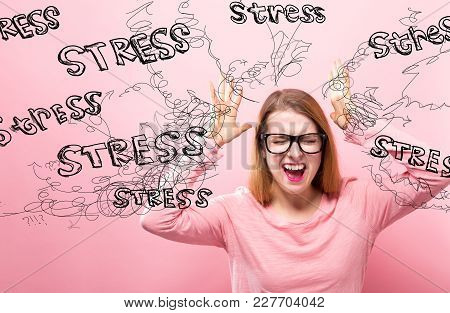 Stress With Young Woman Feeling Stressed On A Pink Background