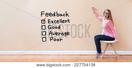 Feedback With Young Woman Holding A Pen In A Chair