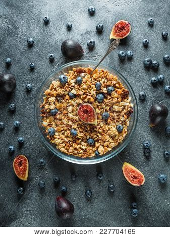 Homemade Tasty Muesli With Nuts In Glass Bowl, Berries And Figs Fruits. Healthy Vegetarian Breakfast