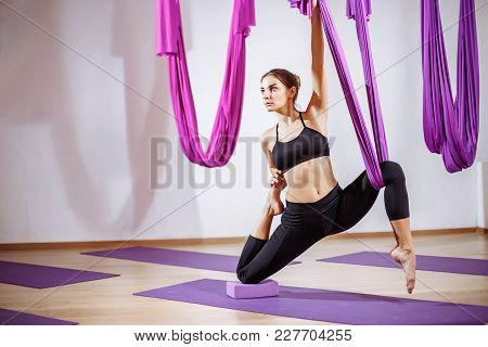 Portrait Young Women Making Antigravity Yoga Exercises. Aerial Aero Fly Fitness Trainer Workout. Med