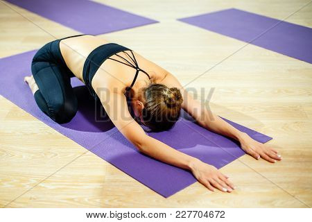 Beautiful Athletic Young Female Make Yoga Balasana