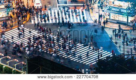 Pedestrians Cross The Shibuya Scramble Crosswalk In Tokyo, Japan, One Of The Busiest Intersections I