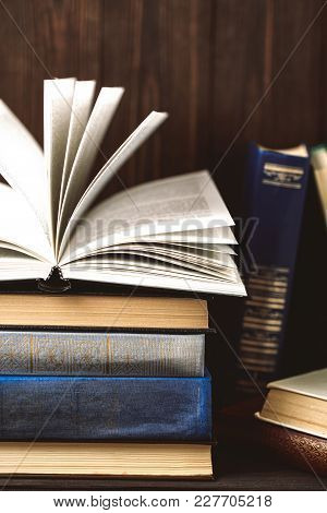 Old books on wooden background. The source of information. Books indoor. Home library. Knowledge is