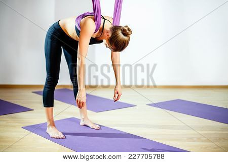 Portrait Young Woman Making Antigravity Yoga. Aerial Aero Fly Fitness Trainer Workout. Harmony And S