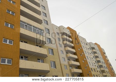 Modern multistory apartment buildings. Apartment blocks. Residential buildings. Building fragment. Housing estate. Contemporary architecture