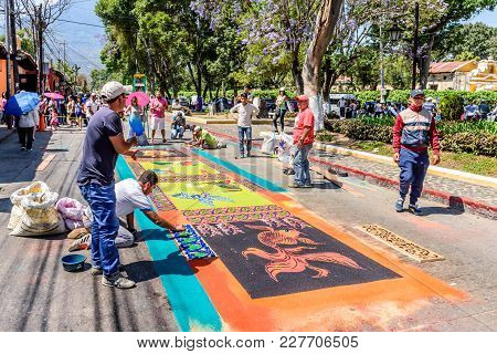 Antigua, Guatemala -  April 13, 2017: Making Holy Thursday Dyed Sawdust Procession Carpet In Town Wi