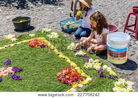 Antigua, Guatemala -  April 13, 2017: Decorating Holy Thursday Procession Carpet In Town With Most F
