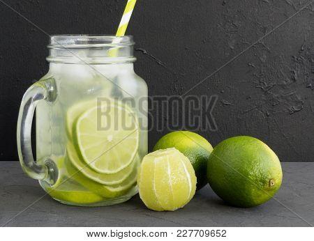 Invigorating Fresh Lemonade With Lime On A Grey Background.