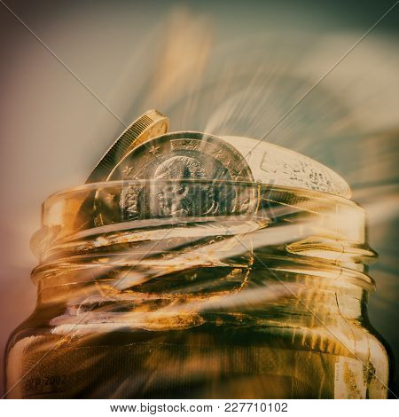 Group Of Coins One Euro In A Glass Jar. Euro Money. Blurred Background. Currency Of The European Uni