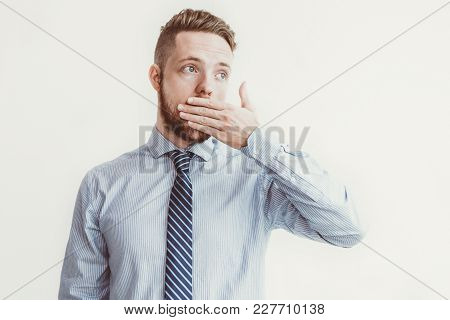 Closeup Portrait Of Surprised Young Business Man Looking Away And Covering Mouth. Isolated Front Vie
