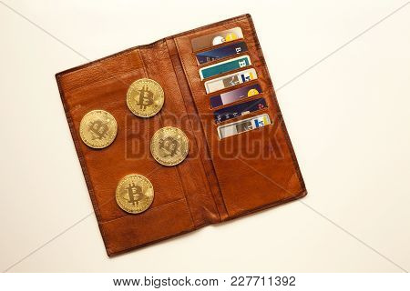 Open Wallet With Four Gold Bit Coin And Credit Cards On Show
