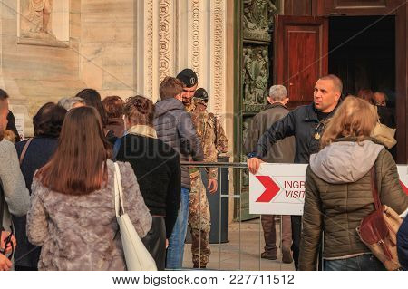 Soldiers Monitor And Control Tourists At The Entrance Of Milan Cathedral