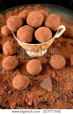 Chocolate Truffles Covered With Cacao In A Ceramic Cup