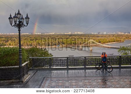 View Of The Pedestrian Bridge Bridge And Rainbow And The Dnieper River From Above, Kyiv, Ukraine