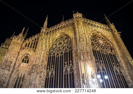 Part Of Facade Of The Famous Milan Cathedral At Night.