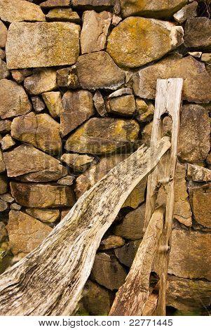 Split Rail Fence By Rock Wall