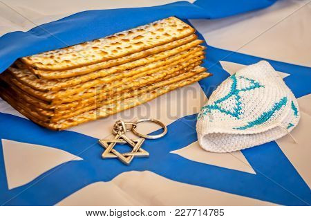 A Pile Of Traditional Jewish Passover Matzah Unleavened Bread Wrapped In The Flag Of Israel With Dav