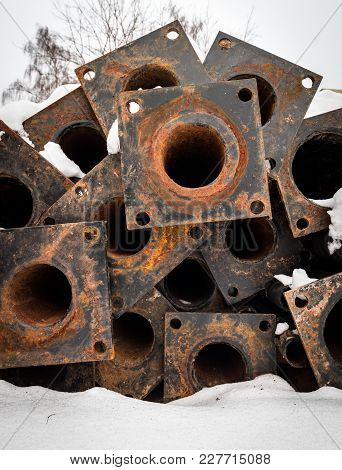 Rusty Pipes On The Snow