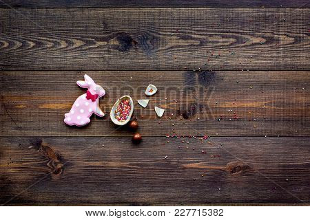 Easter Composition. Easter Sweet Gift. Chocolate Eggs Near Cookies In Shape Of Easter Bunny On Dark