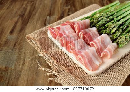 Bacon And Green Asparagus On A Wooden Board. Ingredients For Cooking