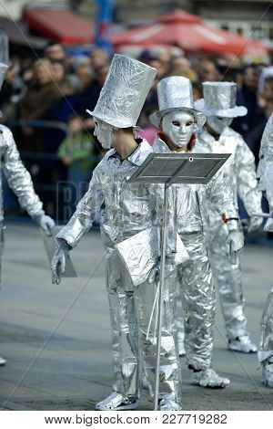 Unrecognizable Man Wrapped With Aluminium Foil, Orchestra Conductor