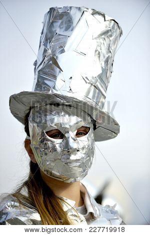 Unrecognizable Man Wrapped With Aluminium Foil,