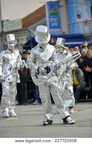 Unrecognizable Man Wrapped With Aluminium Foil, Guitarist