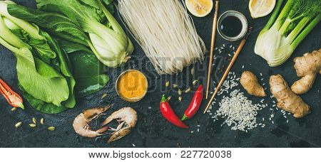 Asian Cuisine Ingredients Over Dark Slate Stone Background, Top View. Vegetables, Spices, Shrimp, Ri