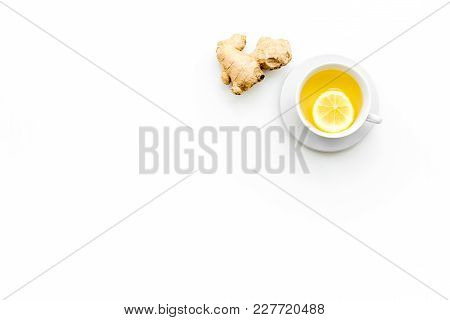 Cup Of Ginger Tea Near Ginger Root On White Background Top View.