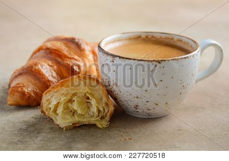 Cup Of Fresh Coffee With Croissants On Dark Background, Selective Focus