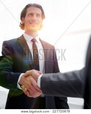 business group welcomes partner with a handshake