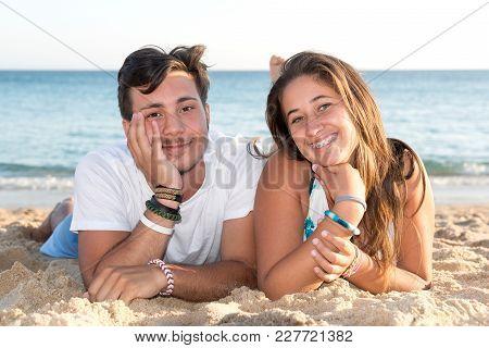 Happy Teenage Couple Posing In The Beach