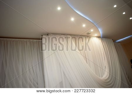 The Ceiling Is Illuminated In The Banquet Hall With A Curtain Of Chiffon . Back