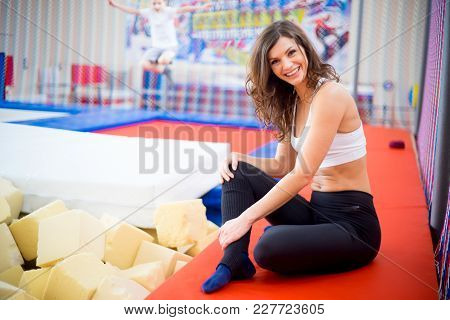 A Portrait Of A Woman In Trampoline Center