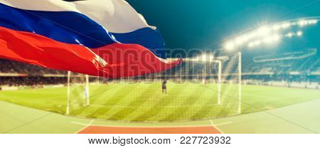 Blurred background of sport arebnal, Russian flag in the focus