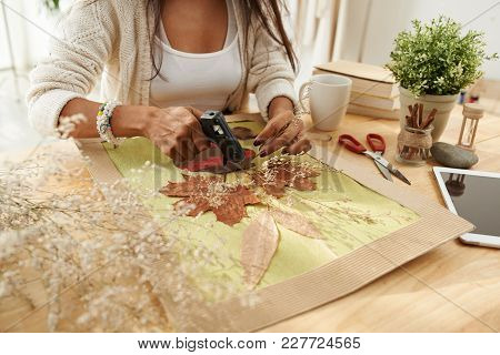 Close-up Image Of Woman Glueing Dry Leaves To Make Beautiful Picture
